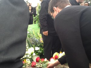 Eric's Dad lays a rose